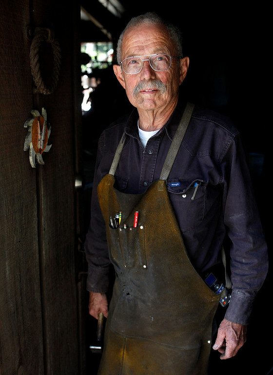 Description of . Blacksmith John Hudson, 78, stands at the doorway to his shop across from Point Lobos in Carmel, Calif. on Wednesday August 21, 2013.  (Photo David Royal/ Monterey County Herald)