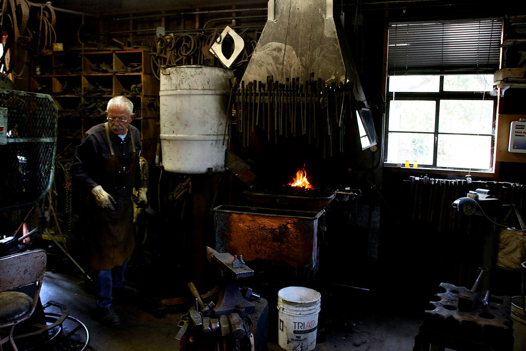 Description of . Blacksmith John Hudson, 78, works at his shop across from Point Lobos in Carmel, Calif. on Wednesday August 21, 2013.  (Photo David Royal/ Monterey County Herald)