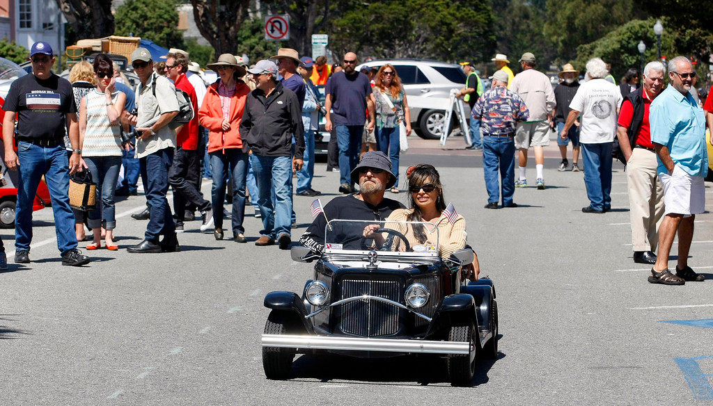 Description of . Bill and Roxanne Hill from Roseville ride in their Mini 32 Ford Model A that Bill built himself at The Little Car Show on Lighthouse Avenue in Pacific Grove on August 14, 2013.  (Vern Fisher/Monterey County Herald)
