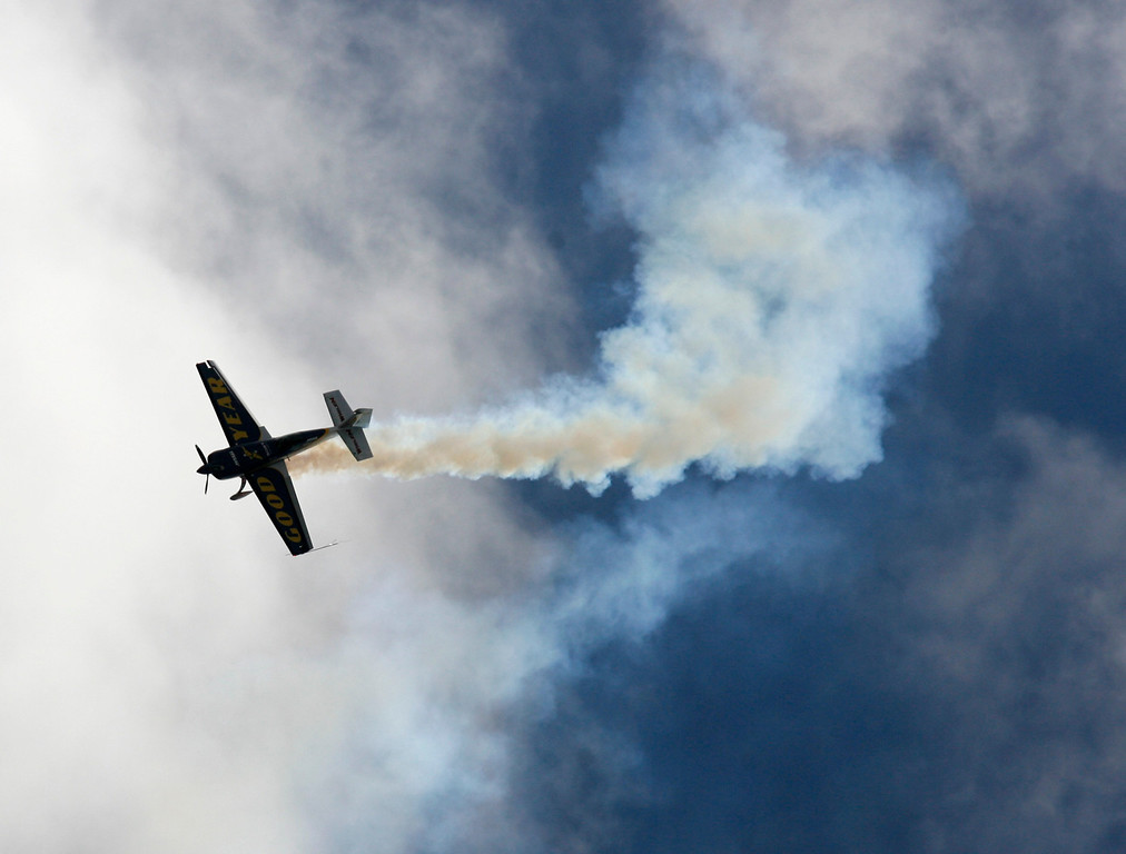 Description of . Michael Goulan soars through cloudy skies in his Extra 330SC during the California International Airshow Salinas at the Salinas Airport in Salinas, Calif. on Saturday September 21, 2013.  (Photo David Royal/ Monterey County Herald)