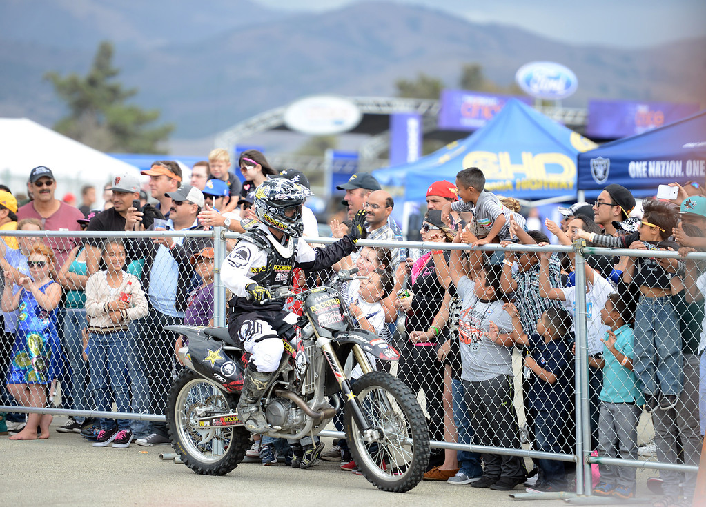Description of . Fans gather to greet Metal Mulisha riders after they performed tricks on their motorcycles during the California International Airshow Salinas at the Salinas Airport in Salinas, Calif. on Saturday September 21, 2013.  (Photo David Royal/ Monterey County Herald)