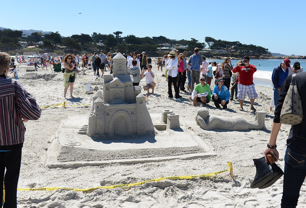 Description of . The Storybook Dreams entry had a castle rising out of a book that a child was reading at Carmel Beach in Carmel, Calif. on Sunday September 15, 2013. The castle, built by the Mehringer Family of Monterey, won the Golden Shovel Award. (Photo David Royal/ Monterey County Herald)
