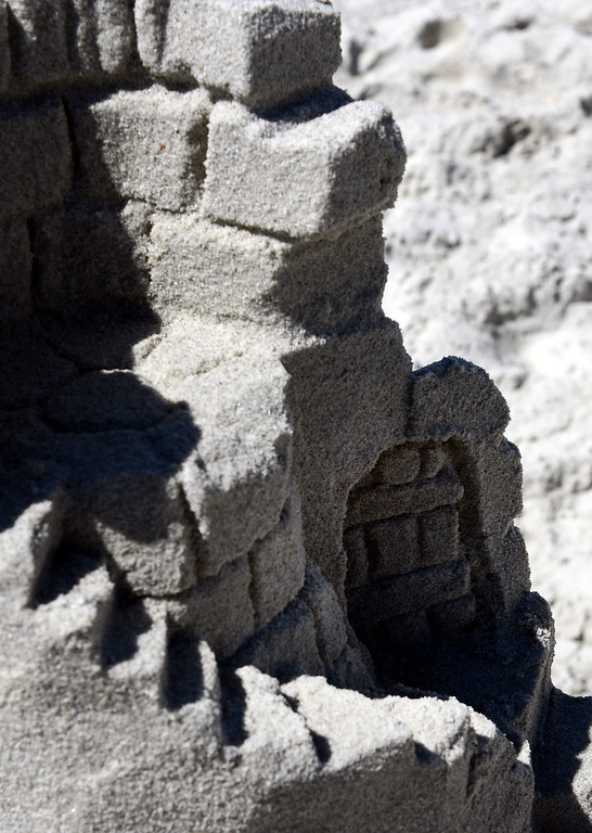 Description of . A detail shot of Sleeping Beauty's Tower built by Scott Weaver during the Sand Castle Contest on Carmel Beach in Carmel, Calif. on Sunday September 15, 2013. (Photo David Royal/ Monterey County Herald)