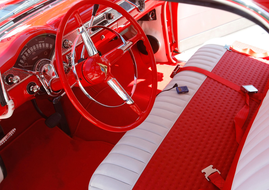 Description of . The pristine red and white interior of a 1955 Chevrolet Nomad at the Concours on the Avenue in Carmel on Agust 13, 2013.  (Vern Fisher/Monterey County Herald)