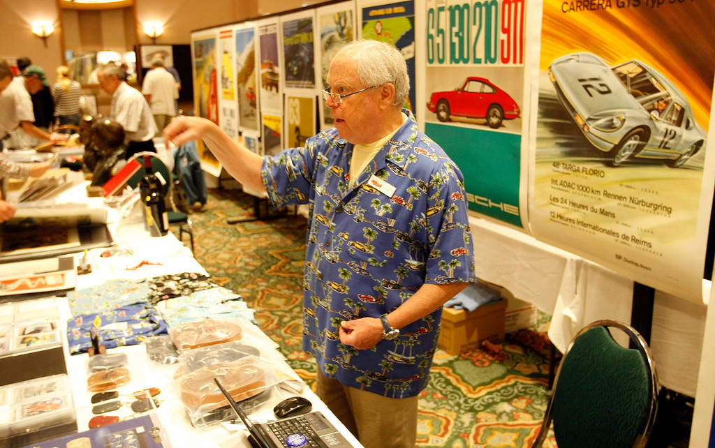 Description of . Tony Singer works his booth at the Automobilia Monterey International Expo at the Embassy Suites in Seaside on August 13, 2013.  (Vern Fisher/Monterey County Herald)