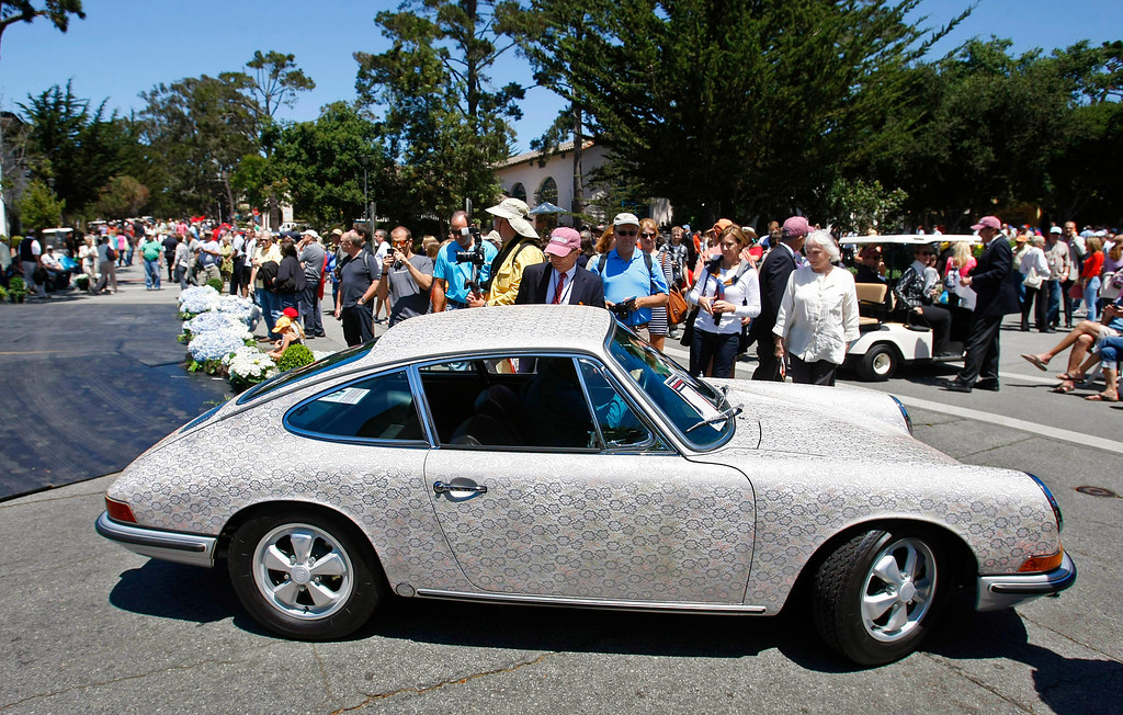 Description of . A 1967 hand painted Porsche 911 belonging to Tim Hensley was a big attraction at the Concors on the Avenue in Carmel on Agust 13, 2013.  (Vern Fisher/Monterey County Herald)