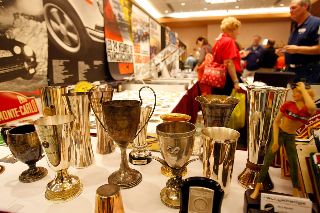 Description of . Old trophy's from auto races for sale at the Automobilia Monterey International Expo on Agust 13, 2013.  (Vern Fisher/Monterey County Herald)
