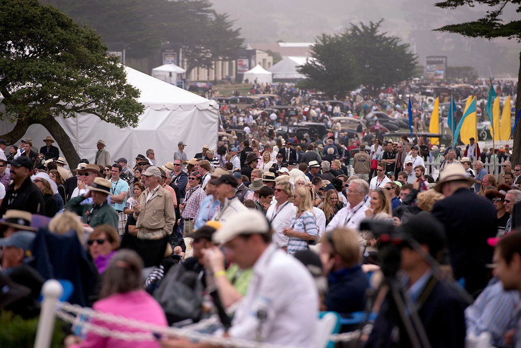 Description of . Cars and people sprawl across the 18th hole at Pebble Beach golf course Sunday, August 18th, 2013 during the 2013 Concours d'Elegance. (Matthew Hintz/Monterey County Herald)