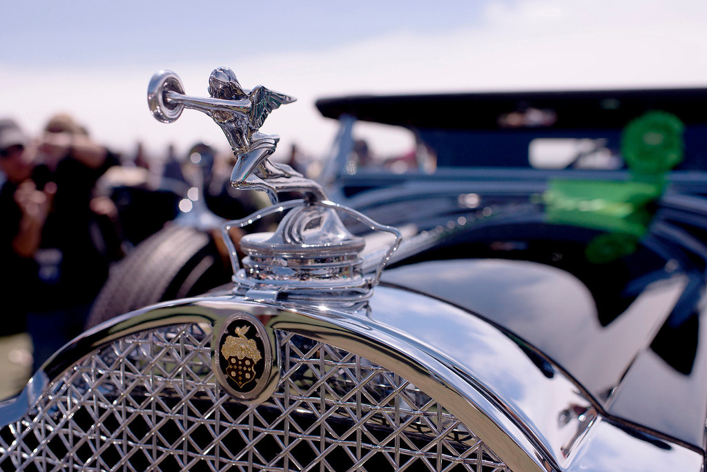 Description of . The hood ornament on a 1931 Packard 840 Custom 8 Sport Phaeton sparkles on the 18th fairway of Pebble Beach Sunday, August 18th, 2013 during the 2013 Concours d'Elegance. (Matthew Hintz/Monterey County Herald)