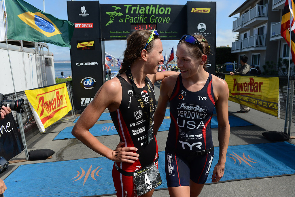 Description of . Womens winner Radka Vodickova of Czechoslovakia, left, and runner up Lindsey Jerdonek of Ohio greet each other after the Elite Race at the Pacific Grove Triathlon in Pacific Grove, Calif. on Saturday September 14, 2013.  Photo David Royal/ Monterey County Herald)