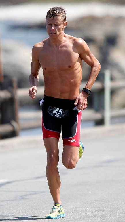 Description of . Mens second place finisher Chris Braden hammers out the final yards to the finish during the Elite Race at the Pacific Grove Triathlon in Pacific Grove, Calif. on Saturday September 14, 2013.  Photo David Royal/ Monterey County Herald)