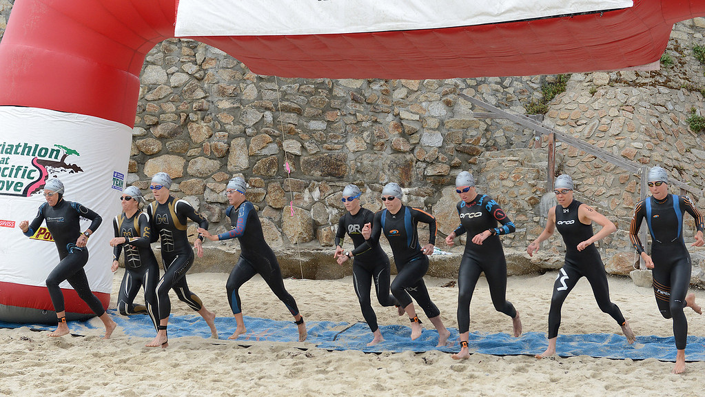 Description of . Women start the swim at Lovers Point Beach during the Elite Race at the Pacific Grove Triathlon in Pacific Grove on Saturday September 14, 2013.  Photo David Royal/ Monterey County Herald)