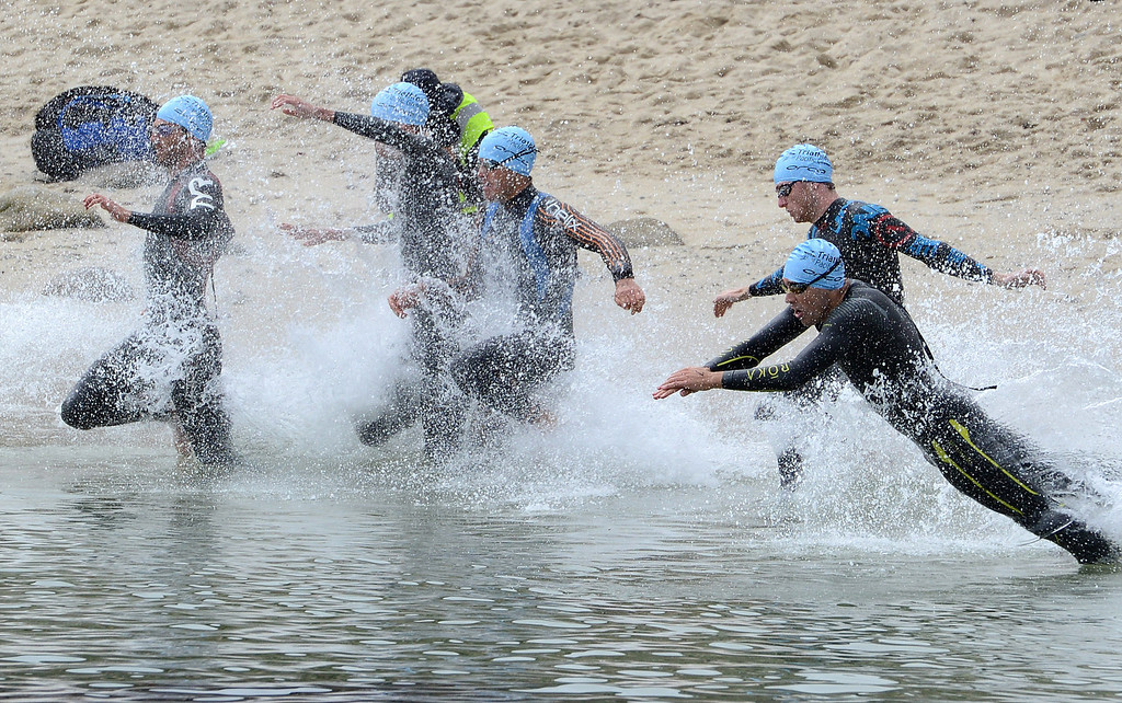 Description of . Men start the swim leg at Lovers Point Beach during the Elite Race at the Pacific Grove Triathlon in Pacific Grove on Saturday September 14, 2013.  Photo David Royal/ Monterey County Herald)