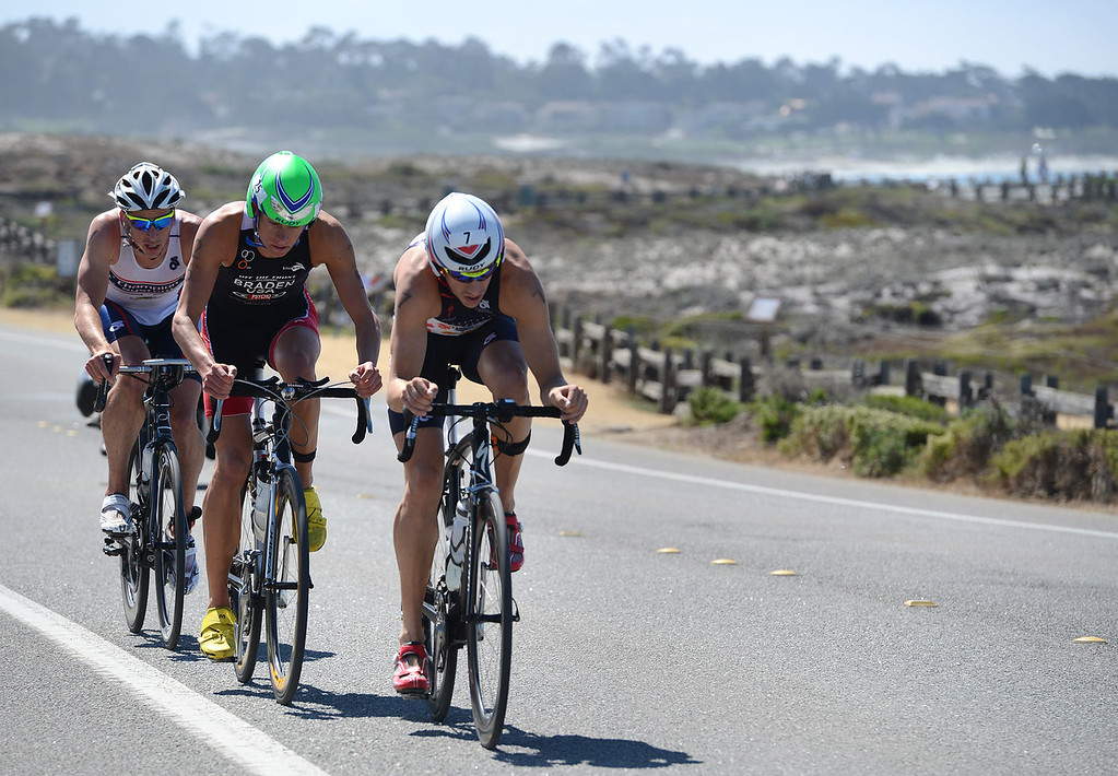 Description of . Mens winner Tommy Zaferes of Aptos, Calif. leads Chris Braden of Boulder and Dustin McLarty of Irvine on the bicycle leg during the Elite Race at the Pacific Grove Triathlon in Pacific Grove, Calif. on Saturday September 14, 2013.  Photo David Royal/ Monterey County Herald)