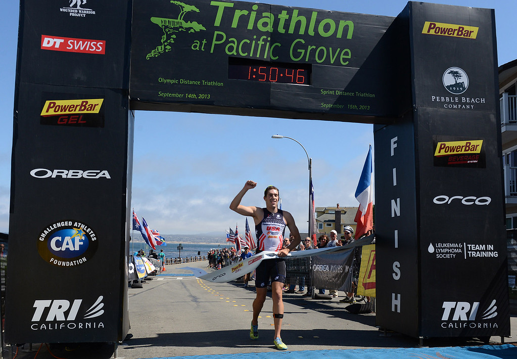 Description of . Mens winner Tommy Zaferes of Aptos, Calif. crosses the finish line during the Elite Race at the Pacific Grove Triathlon in Pacific Grove, Calif. on Saturday September 14, 2013.  Photo David Royal/ Monterey County Herald)