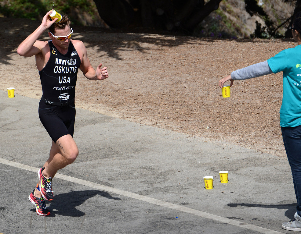Description of . Derek Oskutis dumps water on his head during the Elite Race at the Pacific Grove Triathlon in Pacific Grove, Calif. on Saturday September 14, 2013.  Photo David Royal/ Monterey County Herald)