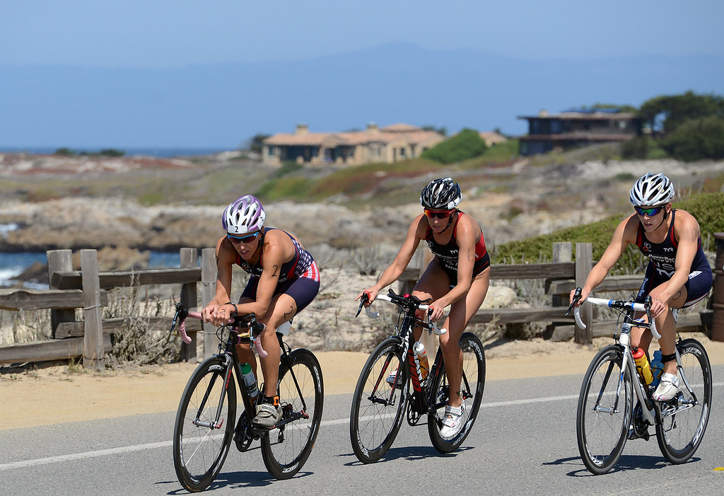 Description of . Julie Ertel, Kelsey Withrow and Lindsey Jerdonek race toward Asilomar Beach during the Elite Race at the Pacific Grove Triathlon in Pacific Grove, Calif. on Saturday September 14, 2013.  Photo David Royal/ Monterey County Herald)