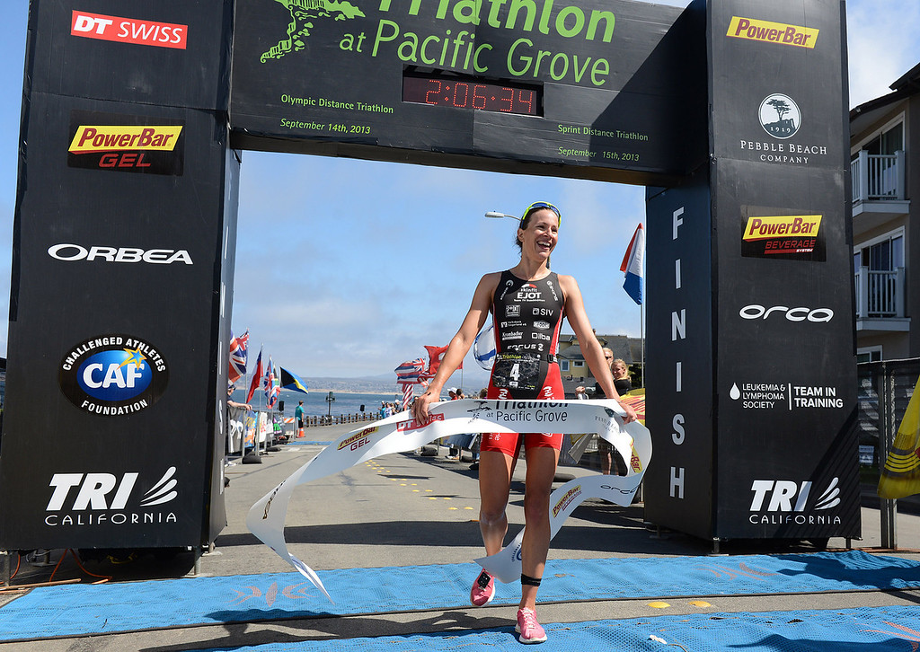 Description of . Womens winner Radka Vodickova of Czechoslovakia crosses the finish line during the Elite Race at the Pacific Grove Triathlon in Pacific Grove, Calif. on Saturday September 14, 2013.  Photo David Royal/ Monterey County Herald)