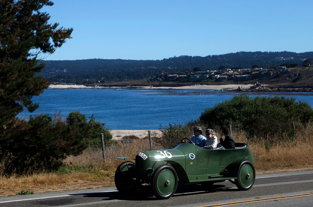 Description of . Everett Louman drives his 1910 Benz 22/80 Prinz Heinrich Renn Wagen past Monastery Beach on the way south toward Big Sur on Highway 1 during Pebble Beach Tour d'Elegance in Carmel, Calif. on Thursday August 15, 2013. The Route starts in Pebble Beach, passes through Laguna Seca Raceway, Carmel Valley and Big Sur before returning to the Monterey Peninsula.  (Photo David Royal/ Monterey County Herald)