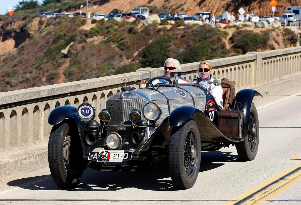 Description of . Frans von Haren drives his 1932 Alfa Romero 8C 2300 Touring Le Mans travels south on Highway 1 over the Bixby Creek Bridge during the Tour d'Elegance on August 15, 2013.  (Vern Fisher/Monterey County Herald)