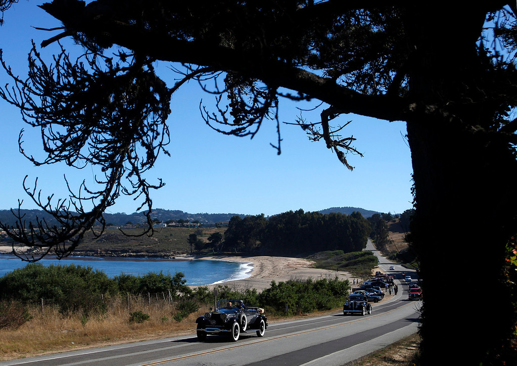 Description of . Classic cars roll past Monastery Beach on their way south toward Big Sur on Highway 1 during Pebble Beach Tour d'Elegance in Carmel, Calif. on Thursday August 15, 2013. The Route starts in Pebble Beach, passes through Laguna Seca Raceway, Carmel Valley and Big Sur before returning to the Monterey Peninsula.  (Photo David Royal/ Monterey County Herald)