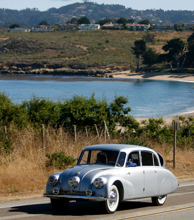 Description of . A 1940 Tatra T87 Sedan rolls owned by John and Sonia Breslow rolls past Monastery Beach on it's way south toward Big Sur on Highway 1 during Pebble Beach Tour d'Elegance in Carmel, Calif. on Thursday August 15, 2013. The Route starts in Pebble Beach, passes through Laguna Seca Raceway, Carmel Valley and Big Sur before returning to the Monterey Peninsula.  (Photo David Royal/ Monterey County Herald)