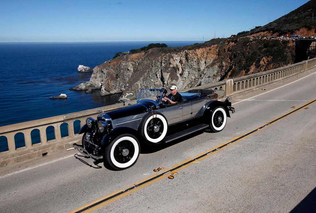 Description of . Robert Berry in his 1921 Lincoln Locke Sport Phaeton traveling south on Highway 1 over the Bixby Creek Bridge during the Tour d'Elegance on August 15, 2013.  (Vern Fisher/Monterey County Herald)