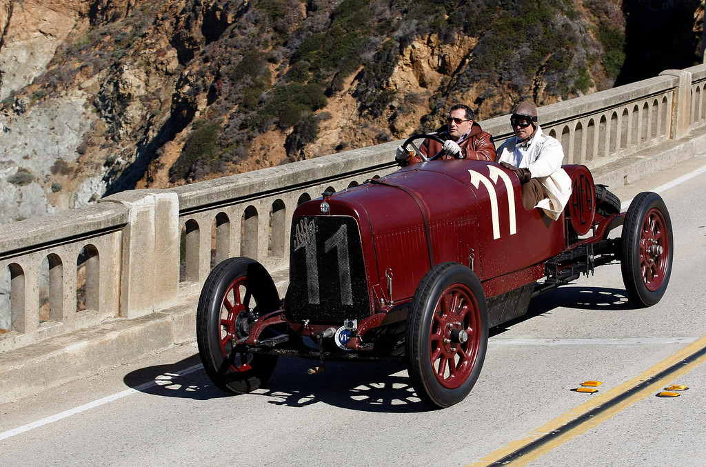 Description of . Tony Shooshani drives his 1921 Alfa Romero G1 Race Car on Highway 1 over the Bixby Creek Bridge during the Tour d'Elegance on August 15, 2013.  (Vern Fisher/Monterey County Herald)
