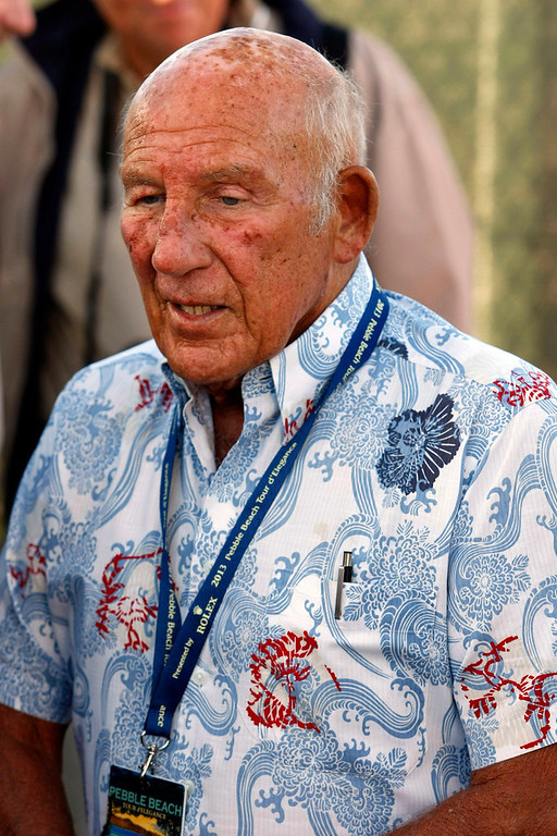 Description of . Famed race car driver Sir Stirling Moss at the Tour d'Elegance in Pebble Beach  on August 15, 2013.  (Vern Fisher/Monterey County Herald)