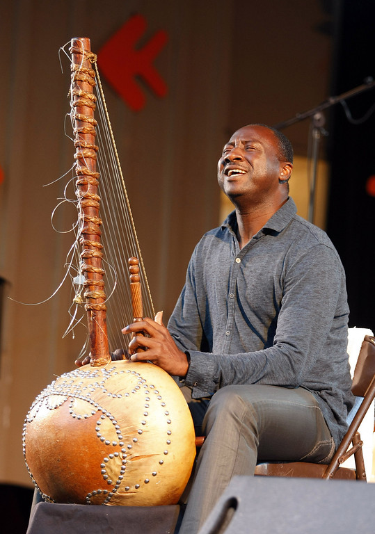 Description of . Sekuo Kouyate plays the Kora with the Roberto Fonseca group on the Garden Stage during the 56th Monterey Jazz Festival at the Monterey Fairgrounds on Sept. 20, 2013.  (Vern Fisher/Monterey County Herald)
