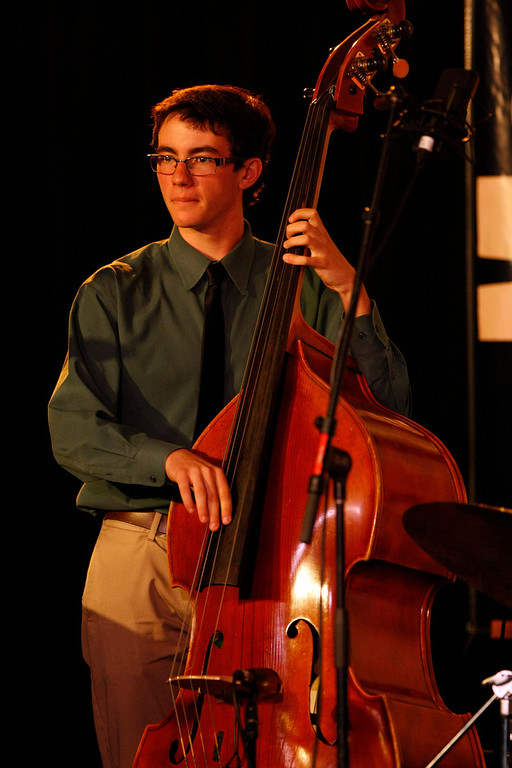 Description of . Max Schwartz of the Berkeley High School Combo A performs at the Monterey Jazz Festival on Sept. 22, 2013.  (Vern Fisher/Monterey County Herald)