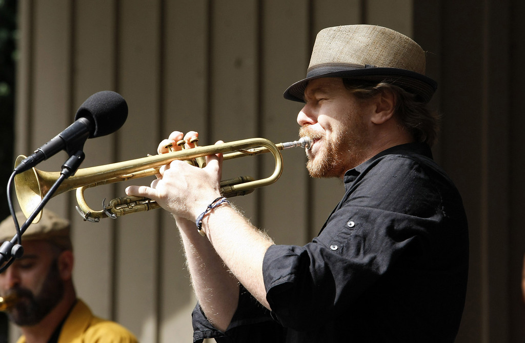 Description of . Lech Wierzynski of the California Honeydrops from Oakland on the Garden Stage at the Monterey Jazz Festival on Sept. 21, 2013.  (Vern Fisher/Monterey County Herald)
