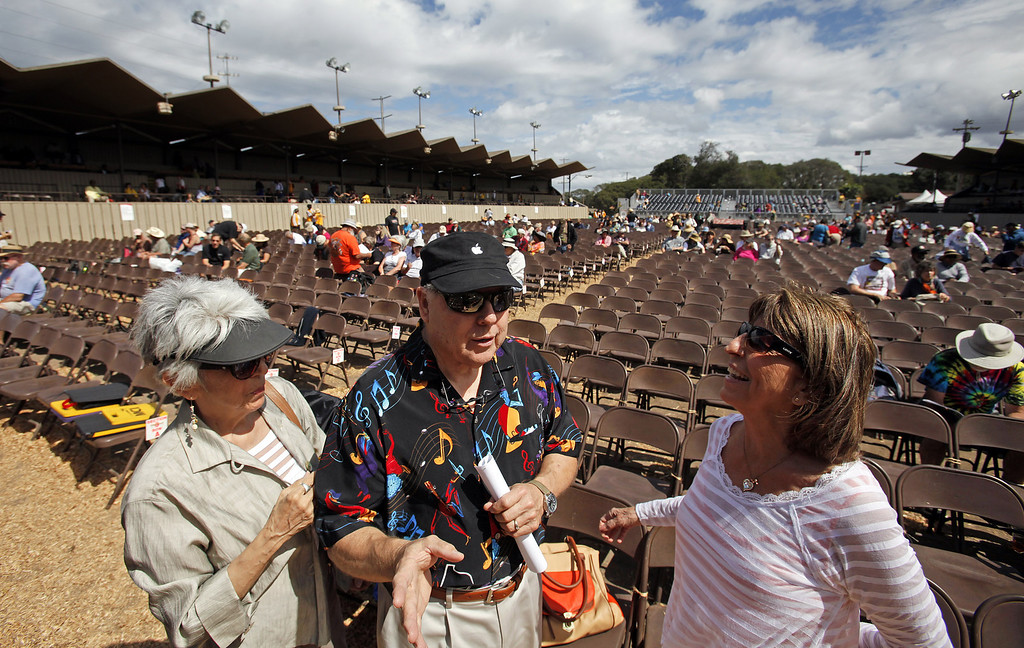 Description of . Thea and Kit Sagen from Oakhurst with Pamm Drake from Oakland at their front row seats in the main arena at the Monterey Jazz Festival on Sept. 21, 2013.  (Vern Fisher/Monterey County Herald)