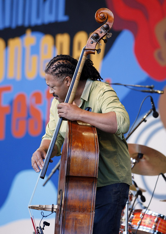 Description of . Bass player James Genus on the Jimmy Lyons Stage at the Monterey Jazz Festival on Sept. 22, 2013.  (Vern Fisher/Monterey County Herald)