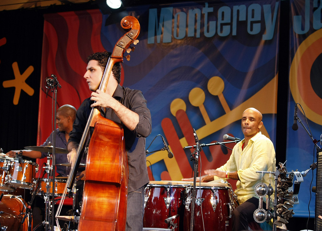 Description of . Bass player Yandy Martnez and drummer Joel Hierrezuelo of the Roberto Fonseca group performs on the Garden Stage during the 56th Monterey Jazz Festival at the Monterey Fairgrounds on Sept. 20, 2013.  (Vern Fisher/Monterey County Herald)
