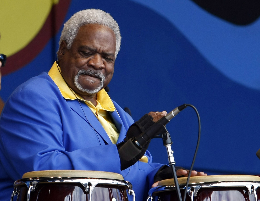Description of . Earnest Tarkington, percussionist with The Relatives, performs in the main arena at the Monterey Jazz Festival on Sept. 21, 2013.  (Vern Fisher/Monterey County Herald)