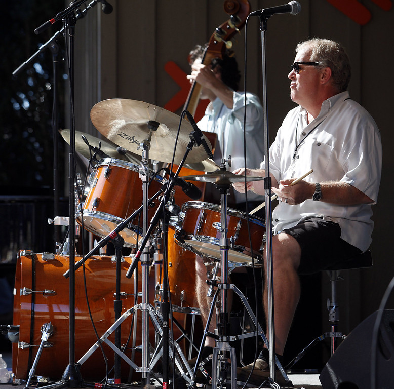 Description of . Drummer Patrick Tregenza with Along Came Betty on the Garden Stage at the Monterey Jazz Festival on Sept. 22, 2013.  (Vern Fisher/Monterey County Herald)