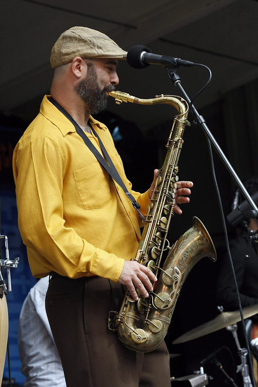 Description of . Johnny Bones, saxaphonist for the California Honeydrops at the Monterey Jazz Festival on Sept. 21, 2013.  (Vern Fisher/Monterey County Herald)