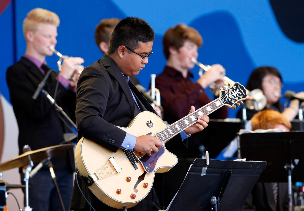 Description of . Guitar play Micah Stevens with the Folsom High School Jazz Band performs at the Monterey Jazz Festival on Sept. 22, 2013.  (Vern Fisher/Monterey County Herald)