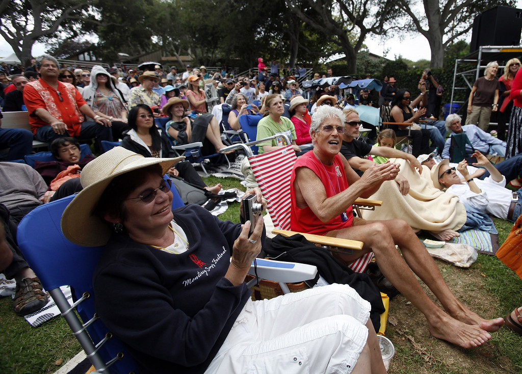 Description of . Crowd enjoying the California Honeydrops fron Oakland on the Garden Stage at the Monterey Jazz Festival on Sept. 21, 2013.  (Vern Fisher/Monterey County Herald)