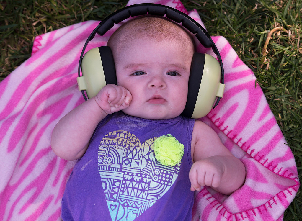 Description of . Sporting a pair of Babybands ear protection, Amanda, 3 months, enjoys herself at First City Music Festival, Saturday, August 24th, 2013 at the Monterey Fairgrounds. (Matthew Hintz/Monterey County Herald)