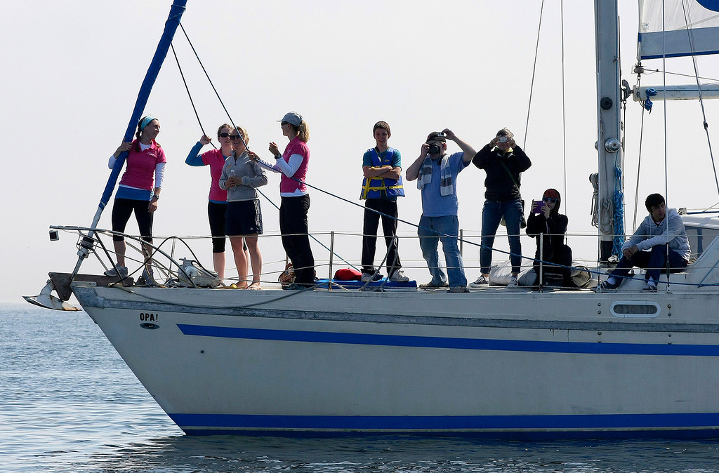 Description of . People watch the start of the Great Pacific Race on June 9, 2014 in Monterey. Thirteen teams from around the world battle it out on a grueling 2,400 mile stretch of the Pacific Ocean from Monterey to Honolulu.  (Vern Fisher - Monterey Herald)