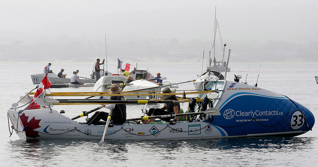Description of . Entrants prepare their boats on June 9, 2014 in Monterey for the start of the Great Pacific Race 2014. Thirteen teams from around the world battle it out on a grueling 2,400 mile stretch of the Pacific Ocean from Monterey to Honolulu.  (Vern Fisher - Monterey Herald)