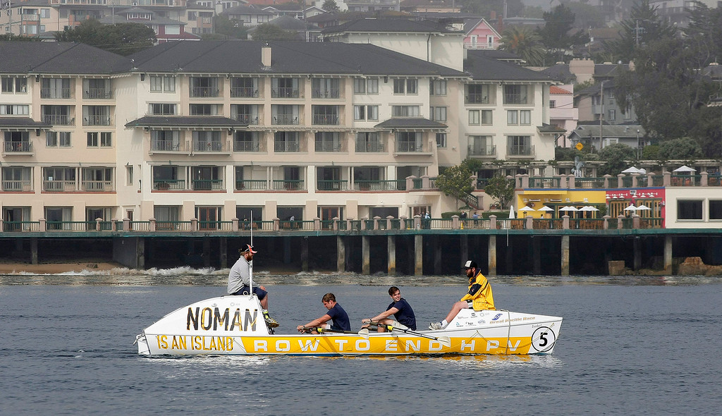 Description of . Team Noman, Nick Kempster, Mark Gleeson, Jack Carter and Chris Blacketer row their boat on June 9, 2014 in Monterey for the start of the Great Pacific Race 2014. Thirteen teams from around the world battle it out on a grueling 2,400 mile stretch of the Pacific Ocean from Monterey to Honolulu.  (Vern Fisher - Monterey Herald)
