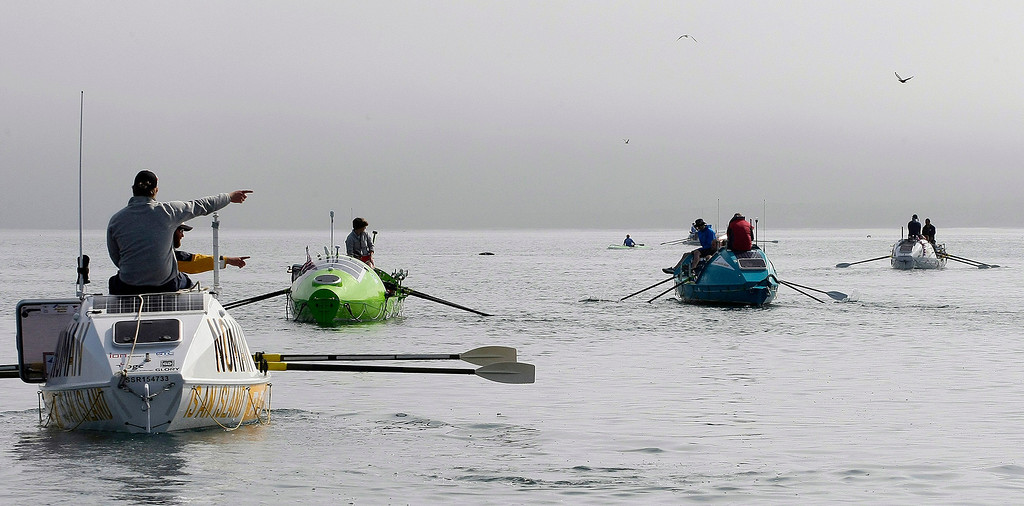Description of . Entrants row their boats on June 9, 2014 in Monterey for the start of the Great Pacific Race 2014. Thirteen teams from around the world battle it out on a grueling 2,400 mile stretch of the Pacific Ocean from Monterey to Honolulu.  (Vern Fisher - Monterey Herald)