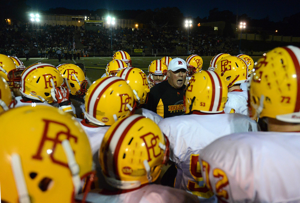 Description of . Pacific Grove head coach Chris Morgan rallies his team during football in Monterey, Calif. on Friday September 20, 2013.  (Photo David Royal/ Monterey County Herald)