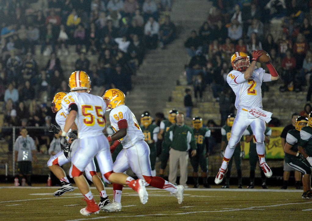 Description of . Pacific Grove's Forest Compton reels in a pass during football in Monterey, Calif. on Friday September 20, 2013.  (Photo David Royal/ Monterey County Herald)