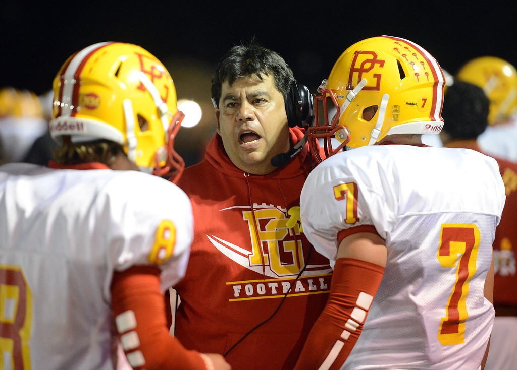 Description of . Pacific Grove assistant coach Todd Buller speaks with players during football in Monterey, Calif. on Friday September 20, 2013.  (Photo David Royal/ Monterey County Herald)