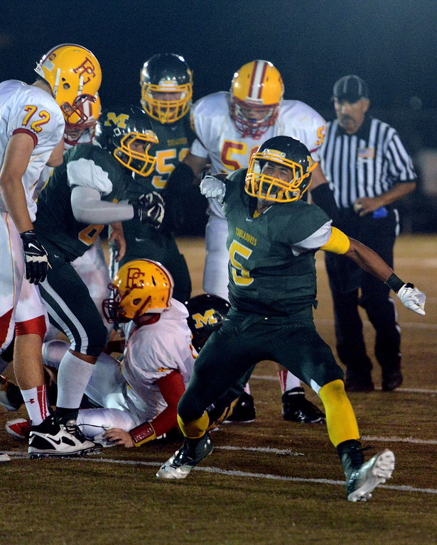 Description of . Monterey's Michael Armstead reacts after sacking Pacific Grove's quarterback during football in Monterey, Calif. on Friday September 20, 2013.  (Photo David Royal/ Monterey County Herald)