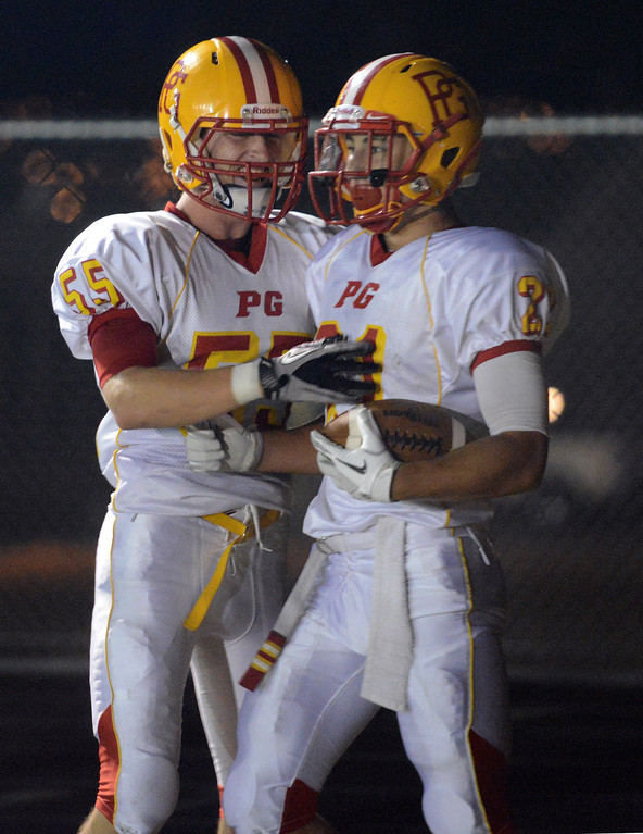 Description of . Pacific Grove's Jake Speed, right, is greeted by teammate Austin Lord after running in a first quarter touchdown during football in Monterey, Calif. on Friday September 20, 2013.  (Photo David Royal/ Monterey County Herald)